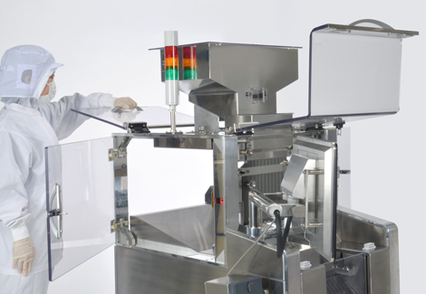 Appearance of Anritsu Capsule Checkweigher with the transparent covers opened.