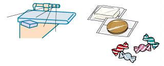 個包装品などの小型・軽量品を高速で選別 - NG products are blown sideways off of the line